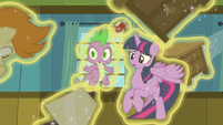 Twilight and Spike surrounded by floating ponies S7E3