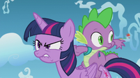 Spike sees filly Rainbow Dash fly by S5E25