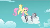Fluttershy gently prods Rainbow Dash S2E02