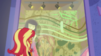 Sunset Shimmer looking at Rarity's display EGDS9