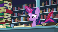 Twilight about to write down on a piece of paper S6E2