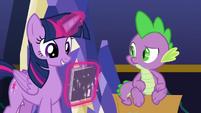 Twilight looks at Power Ponies comic S9E26