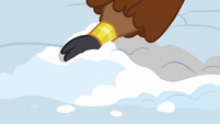 Prince Rutherford lightly digging at the snow S7E11