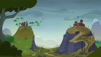 Twilight and Fluttershy fly down to the Hooffields' home S5E23
