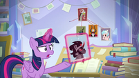 Twilight holding photo of Sombra S9E25