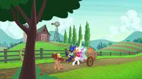 Celestia and Luna on a peach cart ride S9E13