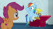 Rainbow Dash holding a trophy S6E14