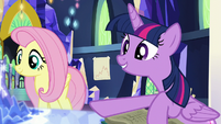 Twilight pointing to a spot on the map S5E23