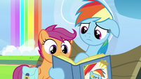 Rainbow Dash showing a picture to Scootaloo S7E7