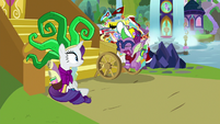 Spike trying to push cart up the castle steps S9E19