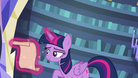 Twilight Sparkle looking at her prepared list S6E21