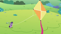 Young Twilight Sparkle flying a kite S9E4