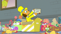 Cheese Sandwich holding up his diploma S9E14