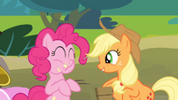 Pinkie Pie eating an apple while Applejack is singing S4E09