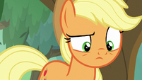 Applejack looks curiously at the bushes S8E23