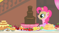 Pinkie Pie looks at the chocolate fountain S1E22