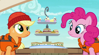 Applejack and Pinkie look at Rarity's snacks S6E22