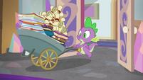 Spike enters with wheelbarrow of binders and scrolls S8E15