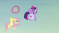 Twilight helps Fluttershy with her saddlebags S5E23