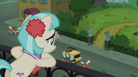 Coco looks over the ruined park S5E16