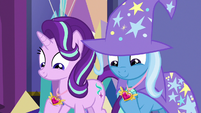 Starlight and Trixie looking at their medals S7E1