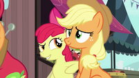 Apple Bloom poking Applejack with her elbow S7E13