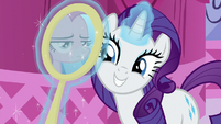 Rarity holding a mirror up to Pinkie Pie S8E18