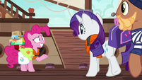 Pinkie Pie grins nervously at Rarity S6E22