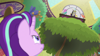 Starlight looking up at Discord's desk S8E15