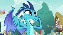 Princess Ember fans herself with her hands S7E15