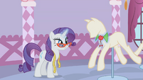 Rarity placing Applejack's collar in a mannequin S1E14