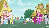 Spike walking through Ponyville S7E15