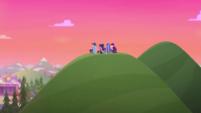 Twilight and teachers sitting on the hill CYOE16a