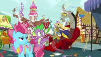 Discord appears reading a book S9E23