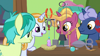 Students observe Dr. Hooves' bird feeder S9E20
