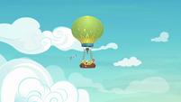Rainbow and hot-air balloon fly through the sky S8E5