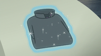 Dress shirt being fluffed and folded S8E4