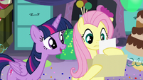 """Fluttershy reads """"Twilight Sparkle likes vanilla ice cream, red balloons, dancing..."""" S5E11"""