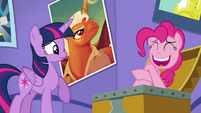 Twilight looks at Pinkie nervously laughing S5E19