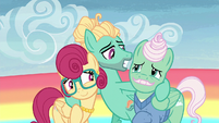 Zephyr puts his hooves around his parents S6E11