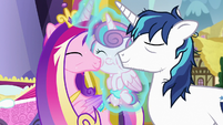 Cadance and Shining Armor kiss Flurry Heart S7E3