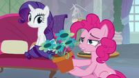 Pinkie Pie holding a flowerpot S8E9