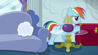 Rainbow Dash pushing a red trunk S6E14