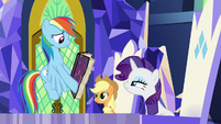 Rainbow Dash shows Rarity's page to her S7E14