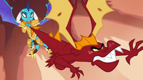 Ember holding Garble by the tail S6E5