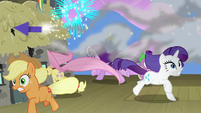 Ponies and Spike run away from flying rockets S8E7