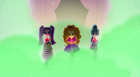 Dazzlings strutting onto ampitheater stage EG2