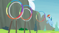 Rainbow Dash about to go through the rings S4E10
