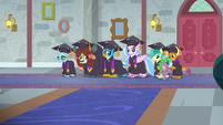 Young Six in graduation gowns S8E26