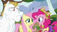 Pinkie Pie in front of Bulk Biceps and Fluttershy S4E10